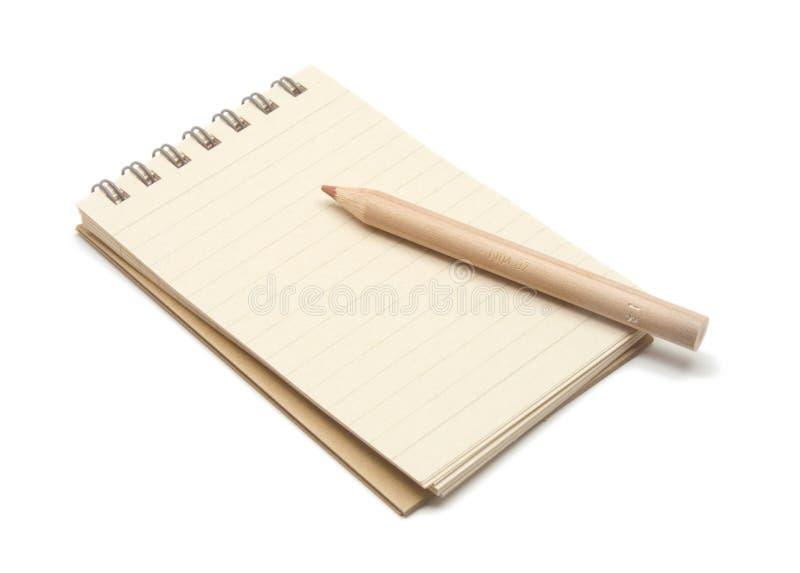 brown notepad ołówek zdjęcie royalty free