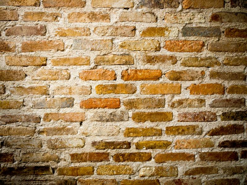 Brown and orange old brick wall texture. Grunge background stock photo