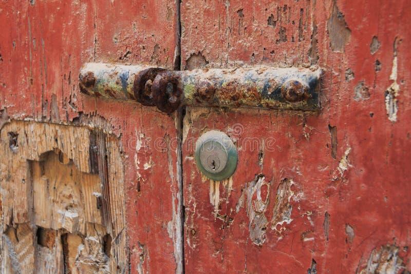 Brown orange rusty old door handle and lock. Valletta, Malta stock photography