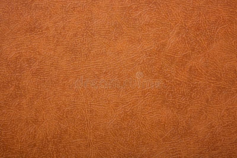 Brown or orange textured leather background. Abstract leather texture. royalty free stock photos