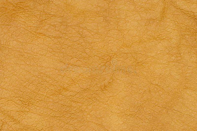 Brown or orange textured leather background. Abstract leather texture. royalty free stock photo