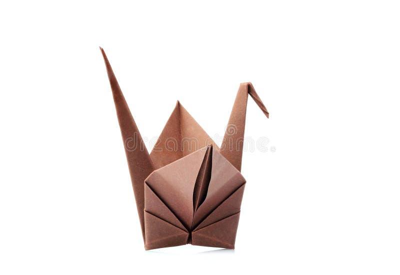 Brown origami żuraw, origami ptak odizolowywający zdjęcia royalty free