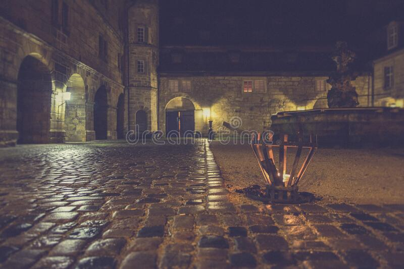 Brown Outdoor Lamp Beside Gray Stone Pavement during Nighttime stock photography