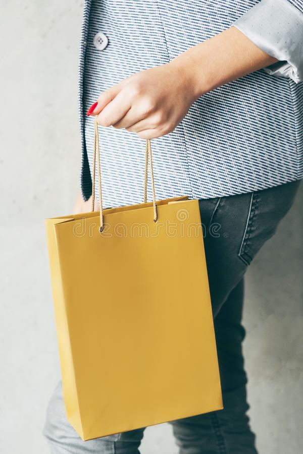 Brown paper bag woman hand consumerism shopping stock image