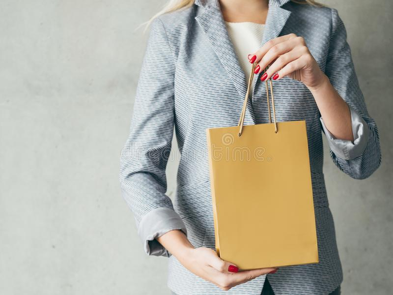 Brown paper bag woman hands presents shopping royalty free stock photo