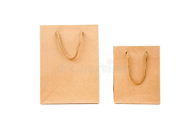 Brown paper bags for shopping isolated on white. Purchase, gift, buy, commerce, design, green, merchandise, packet, present, retail, sale, different, group stock images