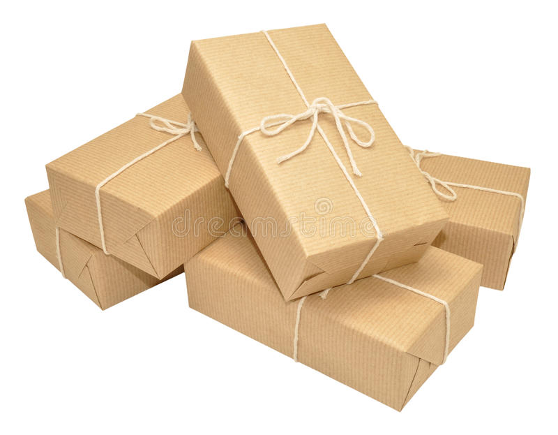 Brown Paper Covered Parcels Tied With String. Group of brown paper wrapped parcels tied with string isolated on a white background stock photography