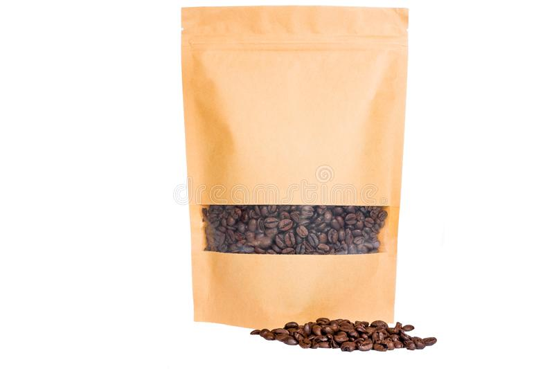 Brown paper doypack stand up pouch with window zipper filled with coffee beans on white background royalty free stock photography