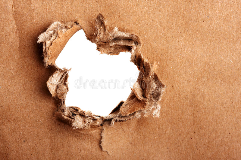 Brown paper with hole royalty free stock images