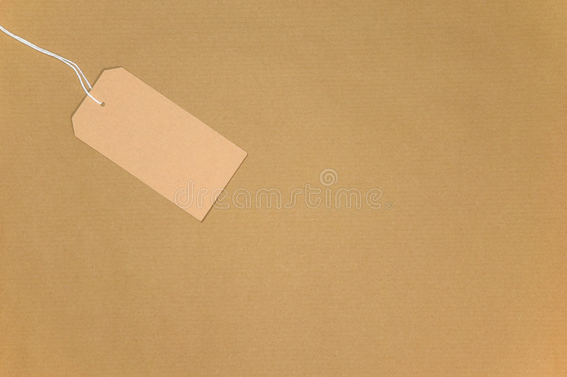 Brown paper and tag. Brown paper with a blank tag on string stock photo