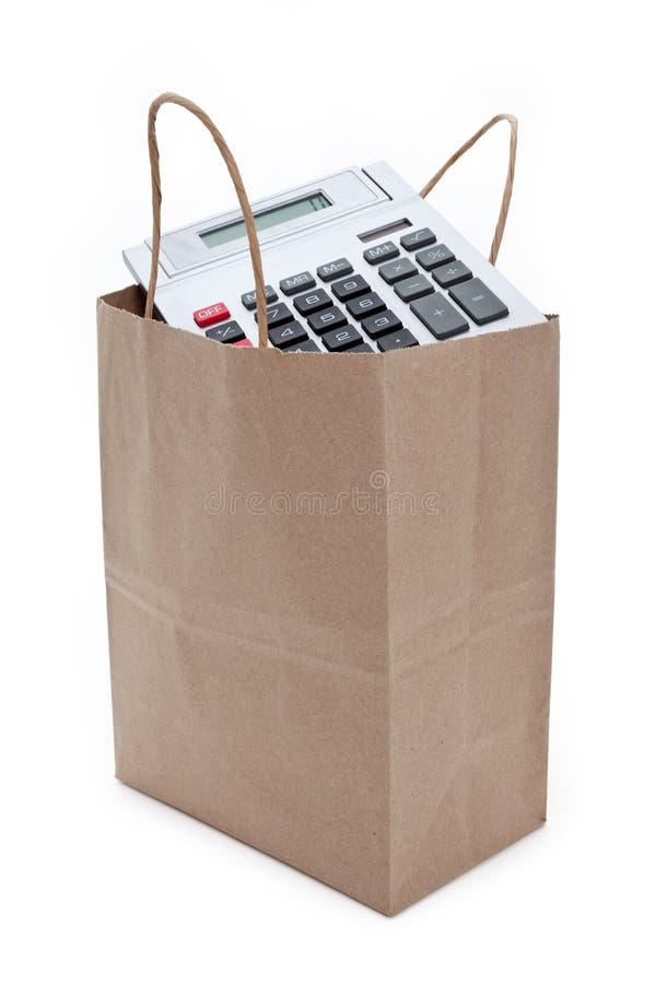 Brown-Papier-Einkaufstasche und -rechner lizenzfreie stockfotos