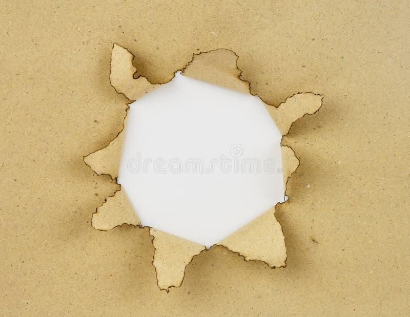 Brown-Papier und weißes Loch stockbild