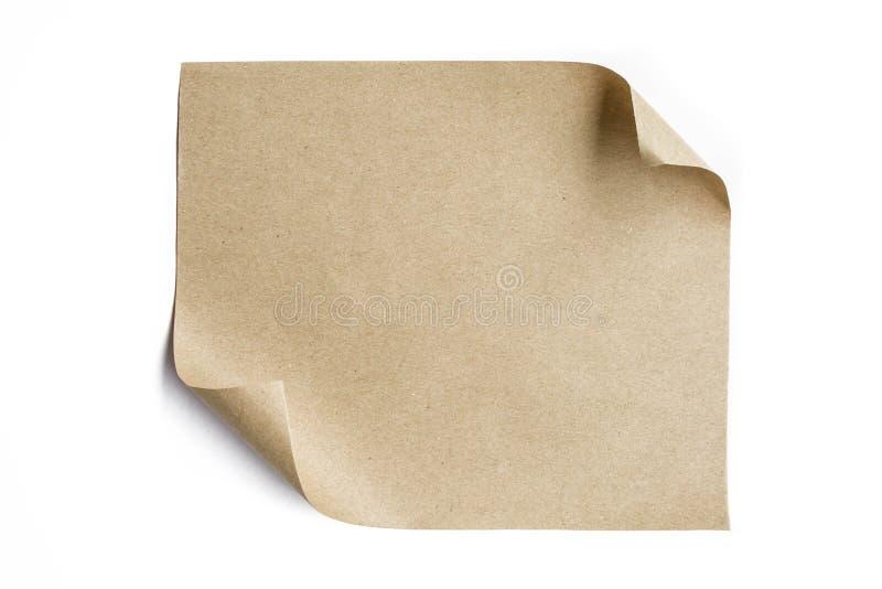 Brown papieru prześcieradło stacza się up odgórnego lewego kąt obrazy stock