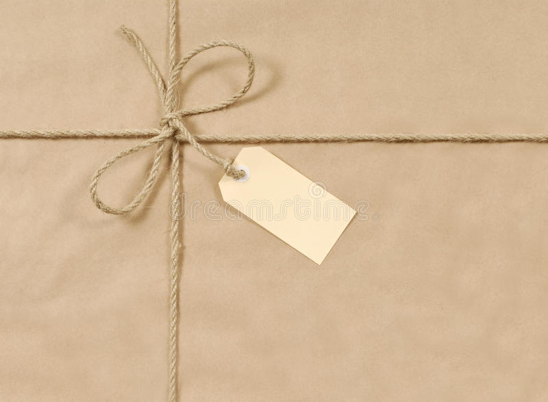 Brown paper parcel background tied with rope or string, gift tag or label, copy space stock images
