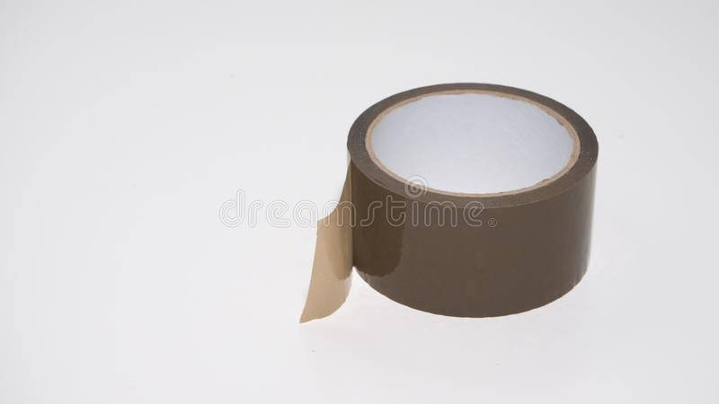 Brown parcel tape roll on white background. stock image