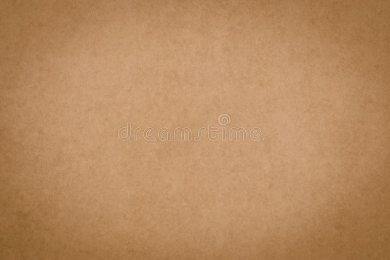 Brown parchment surface, papyrus. Vintage paper sheet texture. Yellow packaging background, dirty card, pattern. Old paper backdro stock photo