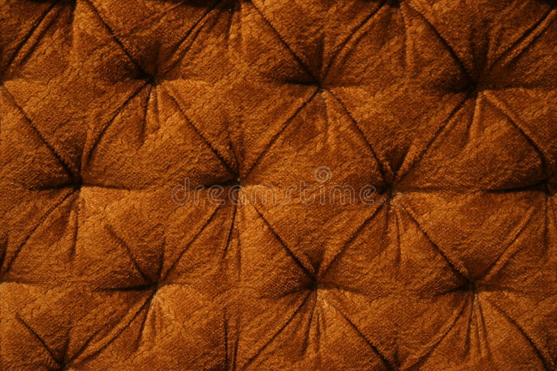 Brown pattern. Fabric upholstery of an old sofa royalty free stock photography