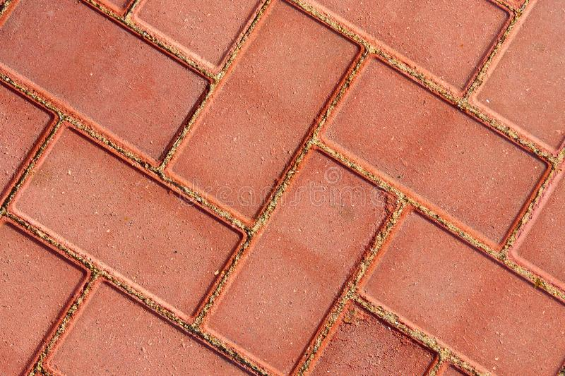 Brown paving tile for background or texture stock images