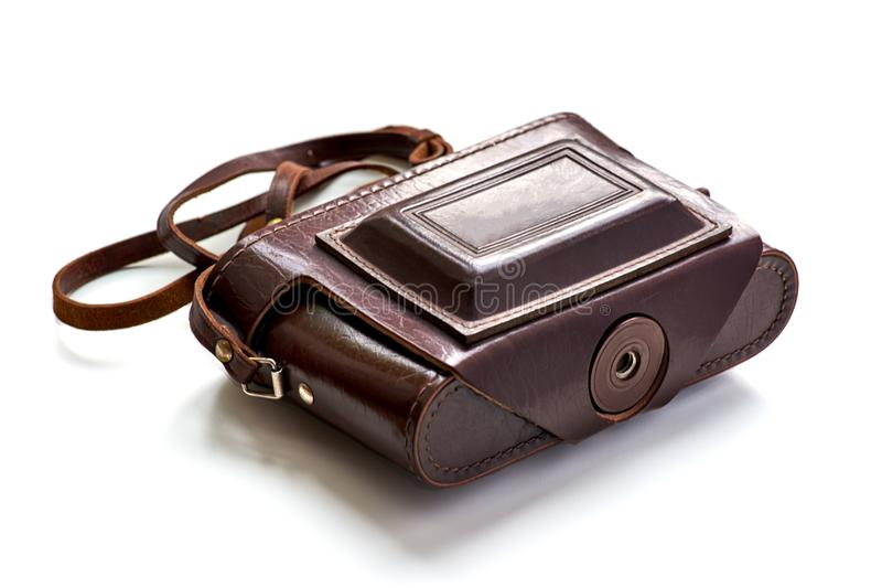 Vintage photo camera in red leather case isolated royalty free stock image