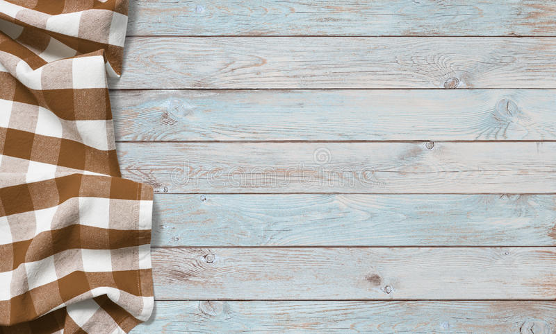 Brown picnic cloth on blue wood table royalty free stock images