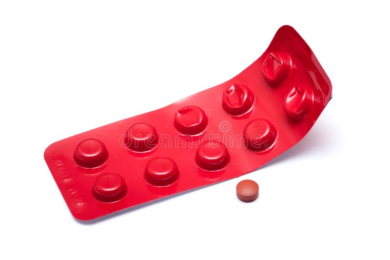 Brown pill and red blister on a white isolated background_ stock photos