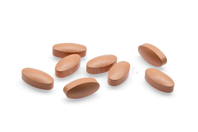 Brown pills isolated on white. Background stock images
