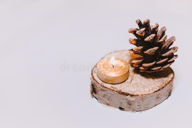 Brown Pine Cone Nut Beside Tealight Candle stock image
