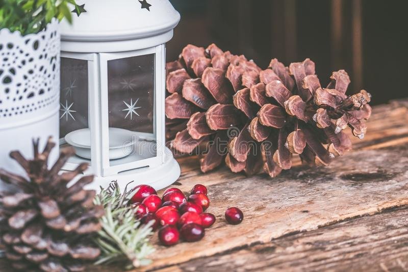 Brown Pinecone Beside Candle Lantern stock images