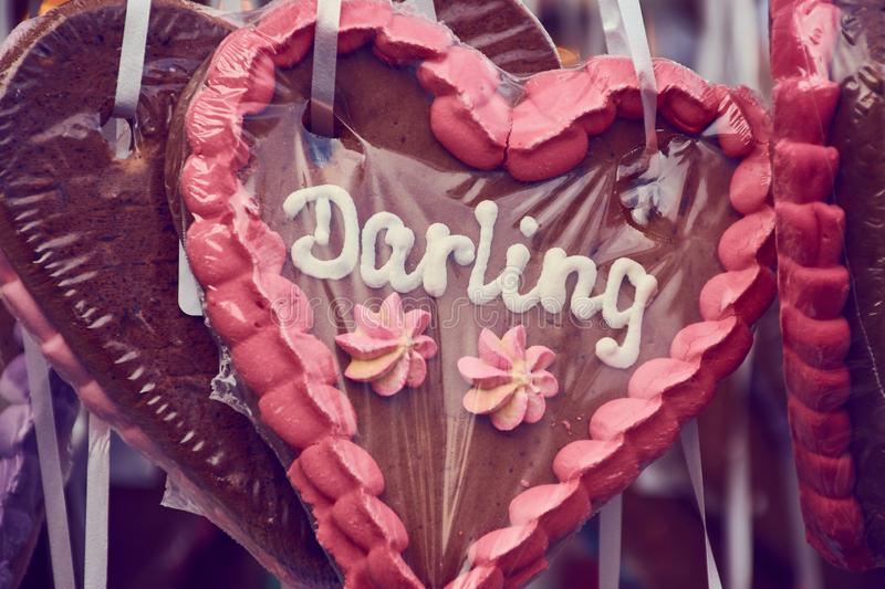 Brown gingerbread heart with the word Darling. Brown pink gingerbread heart with the word `Darling` on it royalty free stock images