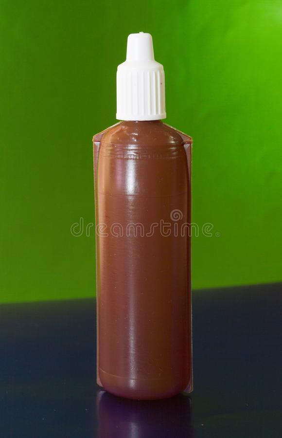 Brown plastic bottle. Drug. packaging for medicines liquid content. green background royalty free stock photos