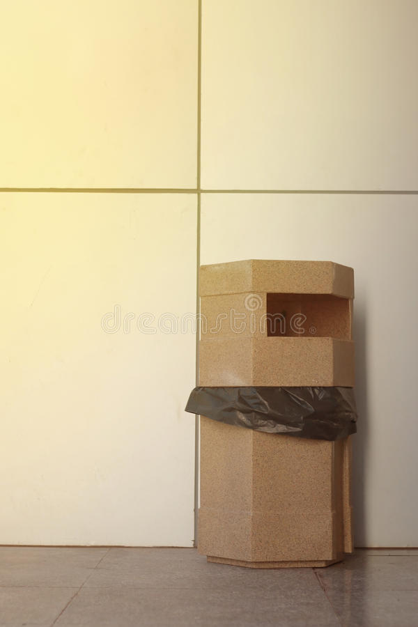 Brown plastic recycle bin and black bag stock photo