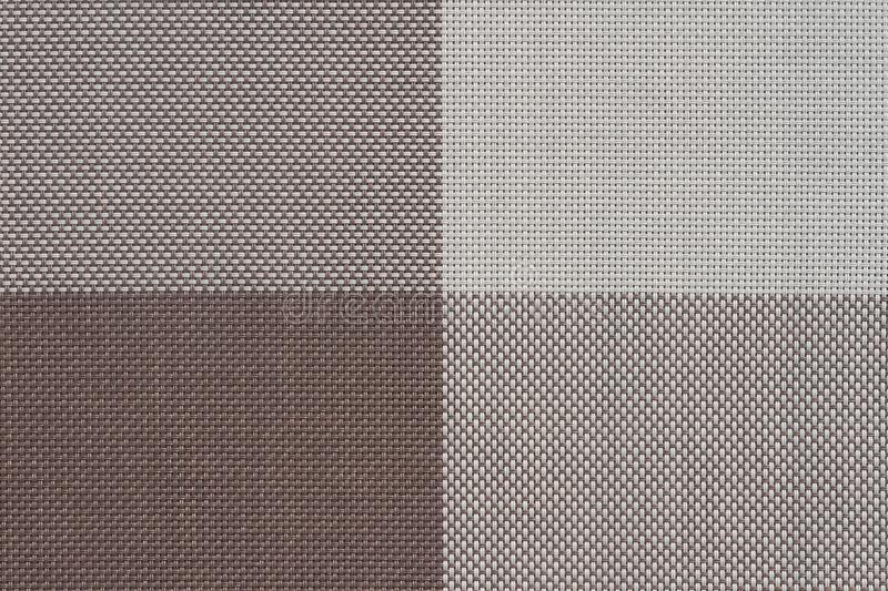 Brown plastic woven fabric samples, texture background. Plastic woven fabric samples, texture background stock photos