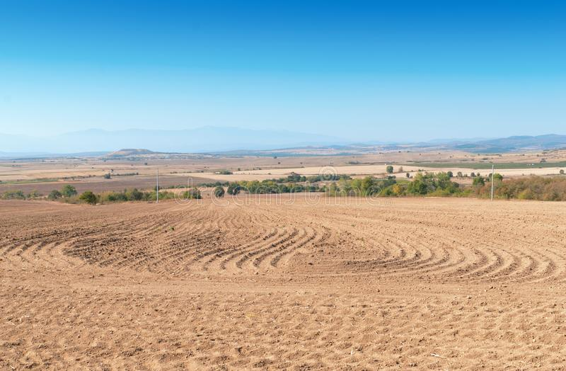Download Brown ploughed field stock image. Image of land, illuminated - 27371533