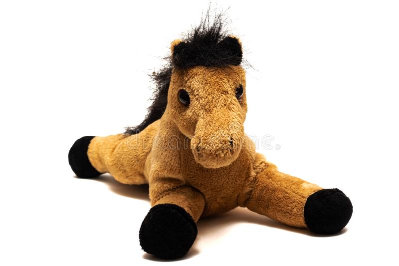 Brown plush toy horse, isolated on white background royalty free stock photos