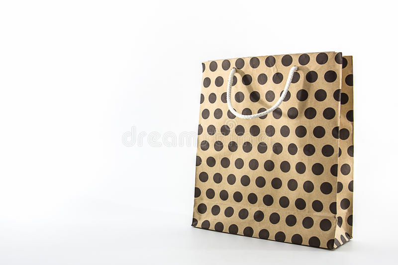 Brown polka dots paper bag. royalty free stock image