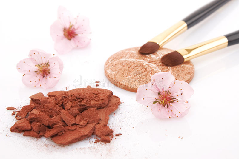 Brown powder for makeup and flowers stock photo