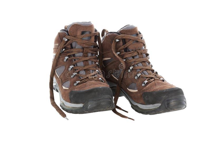 Brown que caminha as botas isoladas em um fundo branco foto de stock