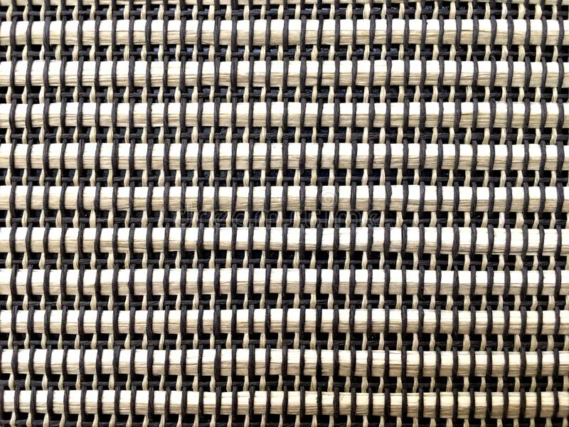 Brown rattan texture weave by black and light brown thread background. Part on vintage loudspeaker stock photo