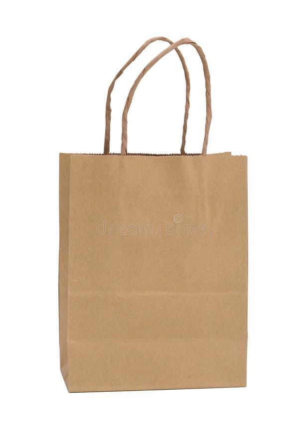 Brown reciclou o saco de portador de papel com os punhos para comprar no fundo branco fotografia de stock royalty free