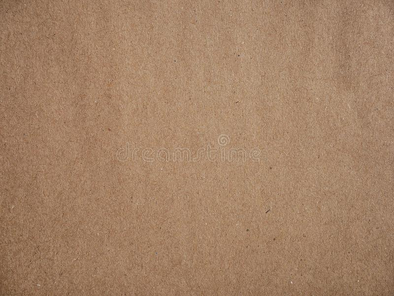 Brown craft carton old rough plain light cardboard background. Brown recycled old paper texture or brown craft carton old rough plain light cardboard background royalty free stock photography