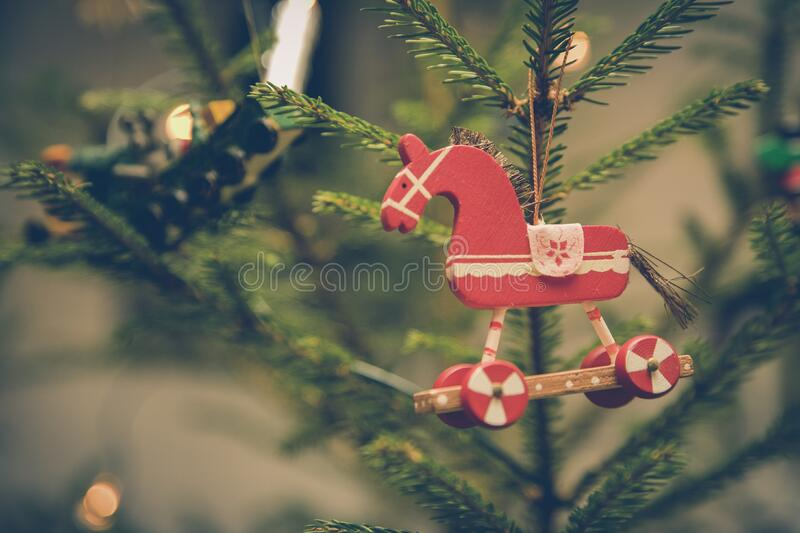 Brown and Red Horse Decor Hanged on Christmas Tree stock photography