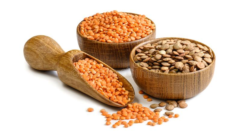 Lentils in a wooden bowls and scoop isolated on white background. Full depth of field stock photography
