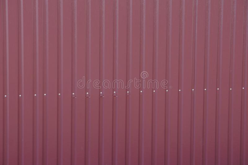 Brown red metal texture from striped iron fence wall stock photography