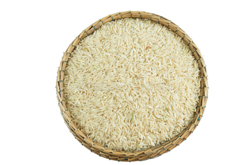 Brown rice on basket isolate on white royalty free stock photo