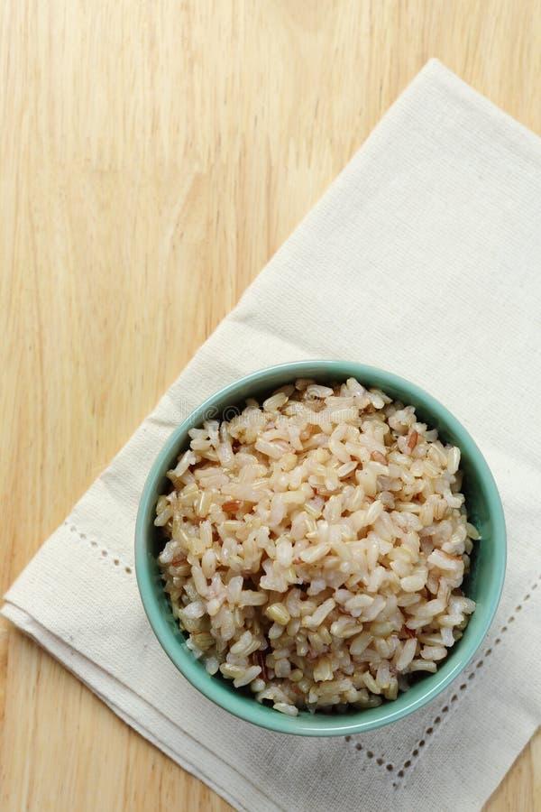The bowl brown Rice on napkin stock photo
