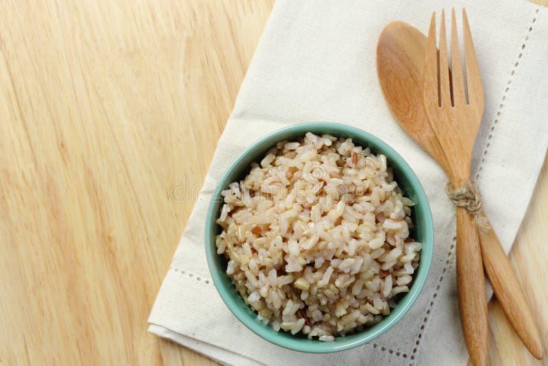The bowl brown rice on napkin royalty free stock photo
