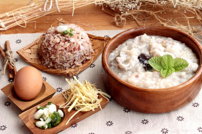 Brown rice porridge put pork and brown rice with soft-boiled egg stock images