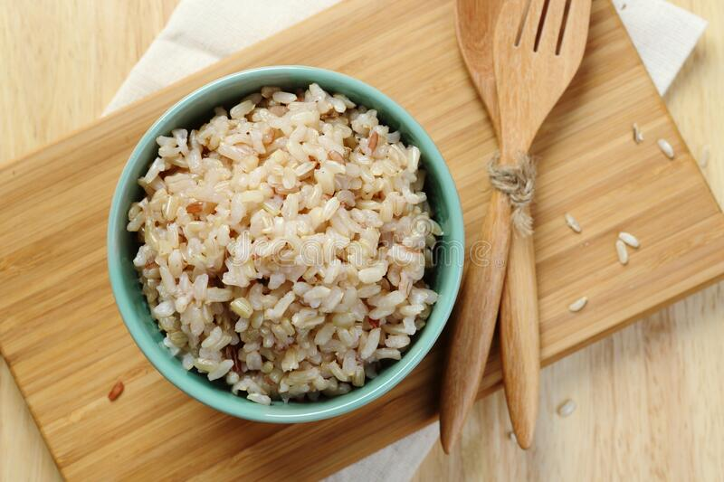 Brown Rice on Wooden Plate royalty free stock photo