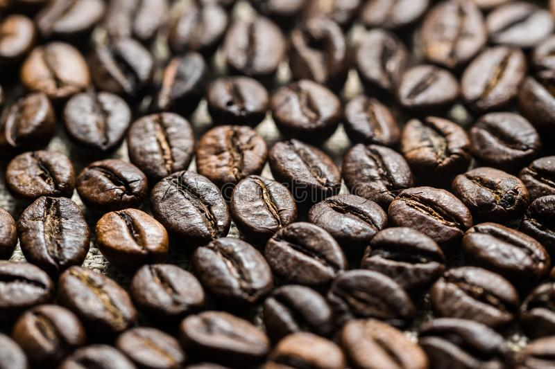 Roasted coffee beans on the background of linen fabric. Brown roasted coffee beans on the background of linen fabric. Background for the decor of cafes and cards stock photos