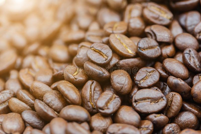 Brown roasted coffee beans texture background for food and drink or agriculture concept design stock photo